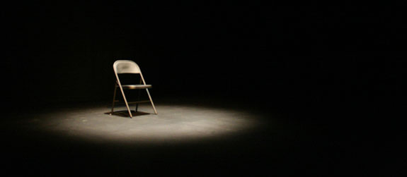 Dark Empty Room Asserting Presence Through With Chair